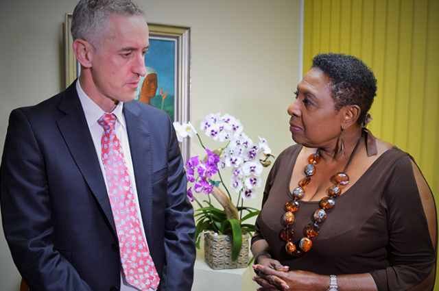 The Minister of Culture, Gender, Entertainment and Sport, the Honourable Olivia Grange (right) listens to a point being made by the Director of Standards and Harmonisation at the World Anti-Doping Agency, Tim Ricketts, during a meeting at her New Kingston office.