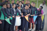 The Honourable Olivia Grange, Minister of Culture, Gender, Entertainment and Sport, cuts the ribbon to signal the official reopening of the diving pool at the National Aquatics Centre yesterday May 18. Members of the National Water Polo team and President of the Amateur Swimming Association of Jamaica, Handel Lamey are also photographed.