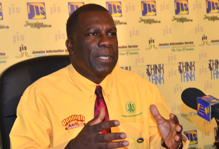 President of the Jamaica Agricultural Society (JAS), Senator Norman Grant, addresses a JIS Think Tank on July 1, where he unveiled plans for  Denbigh 2015.