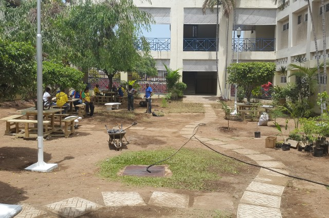 Volunteers take a break from preparing a green area at the Kingston Public Hospital (KPH) today (May 25). The Labour Day project was organised by the Friends of KPH in collaboration with the Kingston Chapter of the Lay Magistrates Association, the Kiwanis Club of New Kingston, and MPM Waste Management Ltd.