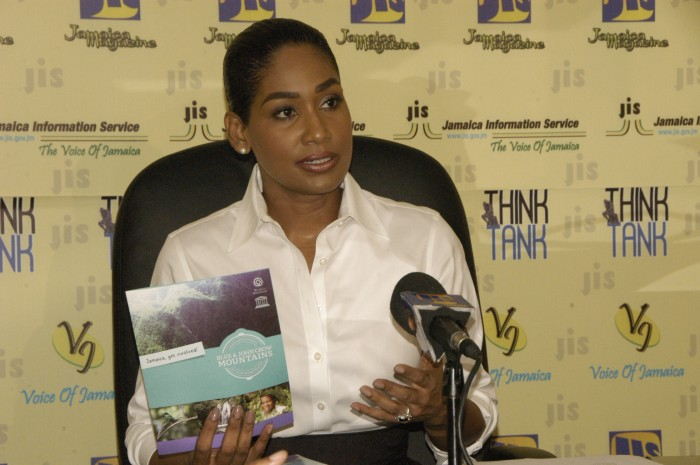 Minister of Youth and Culture, Hon. Lisa Hanna, displays a brochure to be used as part of the public education campaign on the Blue and John Crow Mountains area, recently designated as Jamaica's first World Heritage Site and the Caribbean's first World Heritage Mixed (cultural and natural value) Site. Occasion was a JIS 'Think Tank' on September 29.