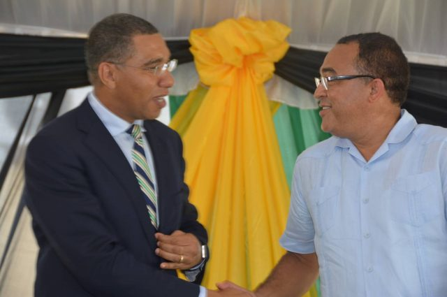 Prime Minister, the Most Hon. Andrew Holness (left), is greeted by Minister of Health, Dr. the Hon. Christopher Tufton, on his arrival for the opening of the expanded operating theatre and the renovated male surgical ward at the St. Ann's Bay Regional Hospital, St. Ann, on October 6.