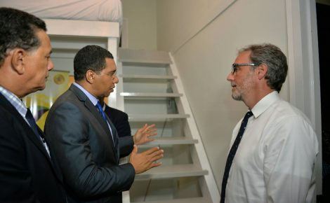 Prime Minister, the Most Hon. Andrew Holness (centre), converses with Co-Founder of Tiny House Enterprises, Andrew Morrison (right), during a tour of a 'tiny house', which was on display at the opening of the Build Expo and Conference at the Montego Bay Convention Centre in St. James on June 9. Looking on is Mayor of Montego Bay, His Worship Homer Davis.