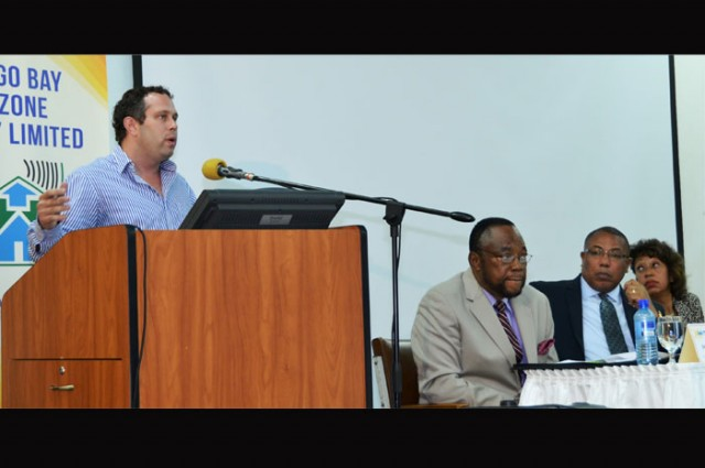 President of the Business Process Industry Association of Jamaica (BPIAJ), Yoni Epstein (at podium), addresses the Montego Bay Free zone Company forum under the theme: 'BPO – exploring opportunities within the sector', which was held  at the Montego Bay Community College recently, as part of the company's 30th anniversary celebration.<br />