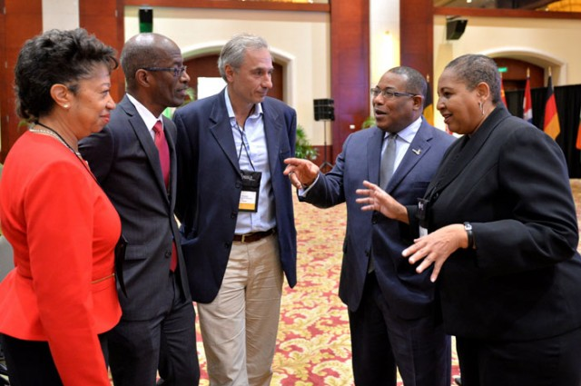 Minister of Industry, Investment and Commerce , Hon Anthony Hylton (2nd right), having a light conversation with ‎(from left):  JAMPRO President, Diane Edwards; J. Wray & Nephew Ltd. Managing Director, Clement Lawrence; General Counsel and Business Development Officer of Gruppo  Campari, Stefano Saccardi, and Senior Director, Corporate Affairs & External Communications at J. Wray & Nephew Ltd, Greta Bogues, at the  Jamaica Investment Forum, at the Montego Bay Convention Centre, today (March 12). The two-day event has attracted more than 137 protential investors from Pakistan, Turkey, China, India, Spain, Belgium,  France, the United Kingdom and other countries across the globe.