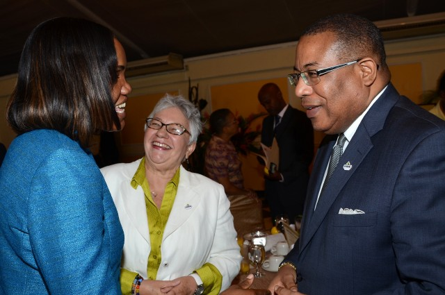 Minister of Industry, Investment and Commerce, Hon. Anthony Hylton (right), engages in a light exchange with (from left): Chief Executive Officer, Jamaica National Agency for Accreditation (JANAAC), Sharonmae Shirley; and Chair of the Inter-American Accreditation Cooperation (IAAC), Ileana Martinez. Occasion was a ceremony held to commemorate World Accreditation Day at the Terra Nova All-Suites Hotel in St. Andrew, on June 9.