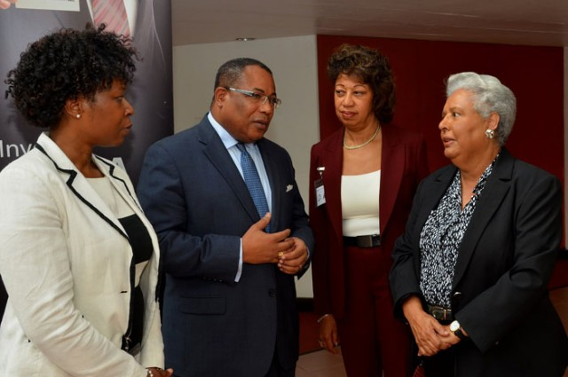 Minister of Industry, Investment & Commerce, Hon. Anthony Hylton (second left), in conversation with (from left), Advisor at the Commonwealth Secretariat, Yinka Bandele; President of Jamaica Promotions Corporation (JAMPRO), Diane Edwards  and President of Jamaica Exporters' Association (JEA), Marjorie Kennedy, at the National Export Strategy (NES) Phase Two Validation Workshop, at the Jamaica Conference Centre, Downtown Kingston, on January 21.