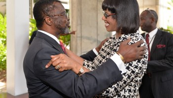 Prime Minister, the Most Hon. Portia Simpson Miller (right), is warmly greeted by International Seabed Authority (ISA) Secretary-General, Nii Odunton, on her arrival at the Jamaica Conference Centre, downtown Kingston, on Tuesday (July 22), for the organisation's commemorative 20th anniversary Special Session.