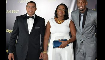 Prime Minister, the Most Hon. Andrew Holness and wife, the Most Hon. Juliet Holness, share a photo opportunity with track and field icon Usain Bolt, at the Caribbean 'I Am Bolt' film premiere at the National Indoor Sports Centre in Kingston on Tuesday, December 6.