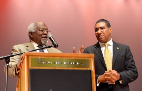 Prime Minister, the Most Hon. Andrew Holness (right), listens as Dr. Julius Garvey, son of National Hero, the Right Excellent Marcus Mosiah Garvey, addresses a town hall meeting in Queens, New York, USA, on September 22.