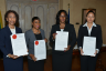 Judges display their Instruments of Appointment following a swearing-in ceremony at King's House on April 13. They are (from left): Justice Jennifer Straw, who will act as Judge of the Court of Appeal; Miss Yvonne Brown, who will act as Puisne Judge of the Supreme Court; Justice Andrea Pettigrew Collins, who will act as Master-in-Chambers of the Supreme Court; and Justice Carolyn Tie who will serve as Master-in-Chambers of the Supreme Court.