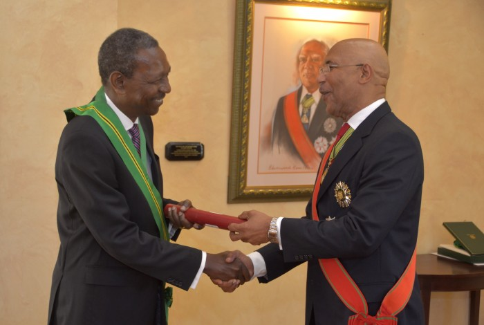 Governor-General, His Excellency the Most Hon. Sir Patrick Allen (right), presents newly appointed President of the Court of Appeal, Justice Cecil Dennis Morrison, with the fifth highest National Honour, the Order of Jamaica, at a swearing-in ceremony, held  at King's House on January 4.