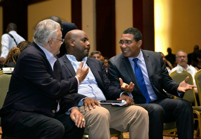 Prime Minister, the Most Hon. Andrew Holness (right) engages in light discussion with Minister of Industry, Commerce, Agriculture and Fisheries, Hon. Karl Samuda (left); and Chairman of Build Expo and Conference 2017, Dwight Crawford, at the opening of the event at the Montego Bay Convention Centre in St. James on June 9.