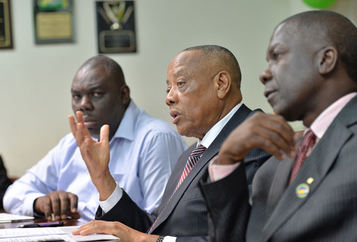 Acting Minister of Agriculture and Fisheries, Hon. Derrick Kellier (centre), responds to a question, during a press conference at the Ministry's Hope Gardens offices in St. Andrew on July 29.  Others are (from left): Permanent Secretary in the Ministry, Donovan Stanberry and President of the Jamaica Agricultural Society (JAS), Senator Norman Grant.