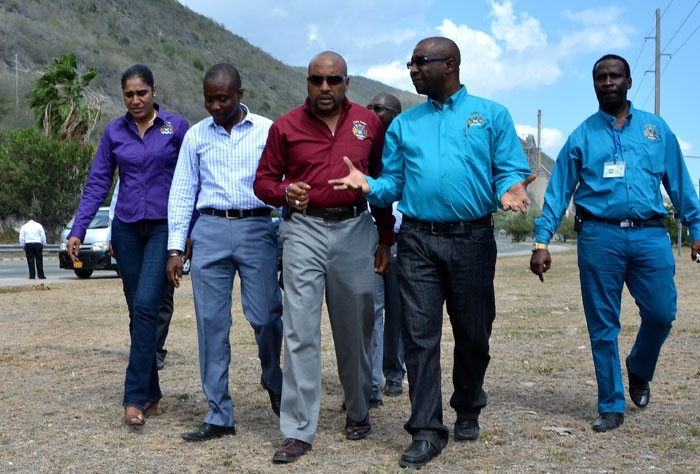 Deputy Mayor of the Kingston & St. Andrew Corporation (KSAC), Andrew Swaby (second right), leads Town Clerk, Robert Hill (third left); City Inspector, Alrick Francis (second left);Treasurer, Nordia Crosskill (left), and Vice-Chairman of the Building & Town Planning Committee, Patrick Roberts (right), on an inspection tour of signs and billboards along the Palisades roadway in East Kingston, on April 15.
