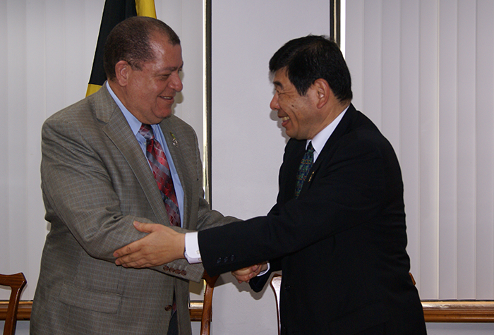 Minister of Finance and the Public Service, the Honourable Audley Shaw greets the Secretary General of the World Customs Organization, Dr. Kunio Mikuriya during a courtesy visit at the Finance Ministry today.