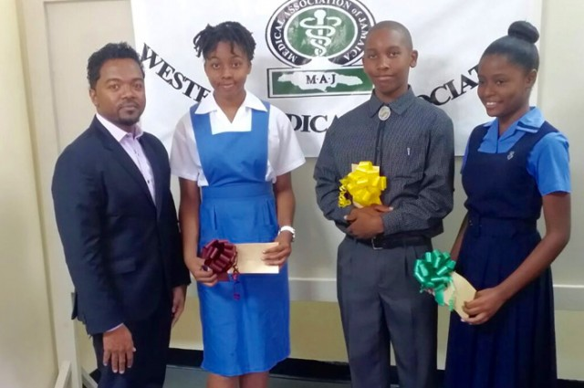 Chairman of the Western Medical Association (WMA), Dr. Garfield Badal (left), with recipients of the 2015 WMA Grade Six Achievement Test (GSAT) award, at a ceremony held on January 24. From second left are:  Jessica McKnight,  Antonio Colman and Candice Owens.