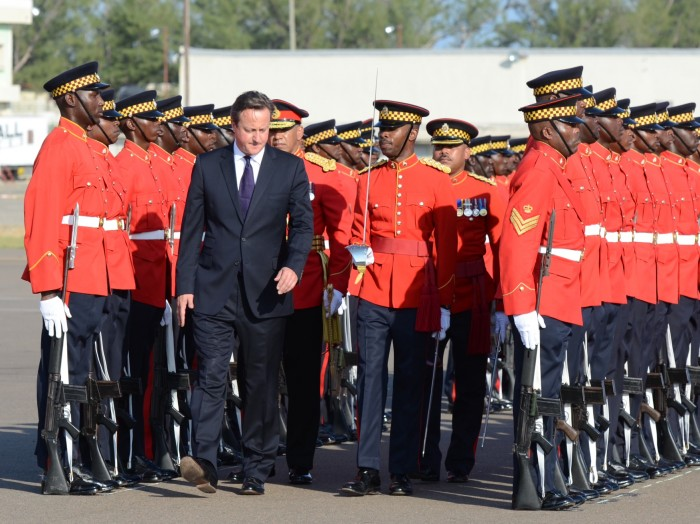 Prime Minister of the United Kingdom (UK), the Rt. Hon. David Cameron (left), inspects the Jamaica Defence Force (JDF) Guard of Honour, when he arrived at the Norman Manley International Airport, in Kingston, today (September 29), for a two-day official visit.