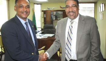 Minister of Tourism and Entertainment, Hon. Dr. Wykeham McNeill (right), is in animated discussion with the newly appointed  Managing Director of the Jamaica Social Investment Fund (JSIF), Mr. Omar Sweeney,  on ways  to boost community participation in the local tourism sector. The occasion was a recent courtesy call by Mr. Sweeney at the Ministry's New Kingston offices.  The two government entities have partnered on a number of development projects including the implementation of a policy and strategy framework to significantly boost community-based tourism projects in Jamaica.  Earlier this month the Ministry's Tourism Product Development Company (TPDCo), in conjunction with JSIF, ran a Rural Economic Development Initiative (REDI) Boot Camp/Workshop for Community Based Tourism Enterprises in Montego Bay.  Representatives of several community-based tourism groups participated in the training camp.