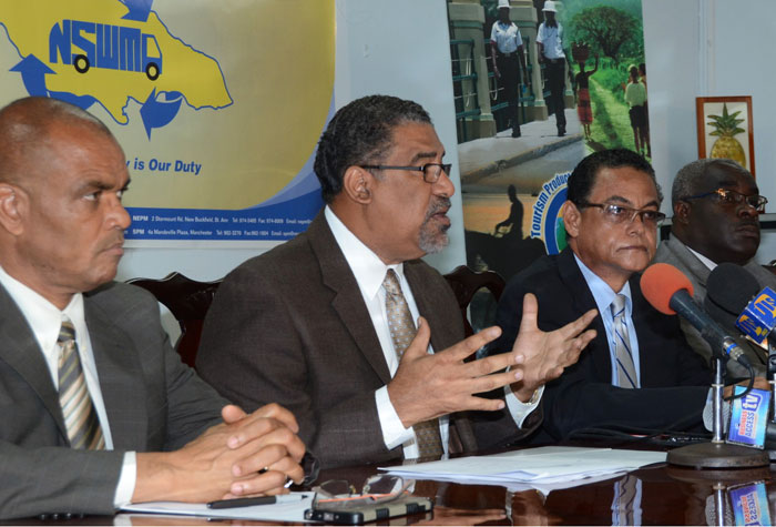 Minister of Tourism and Entertainment, Hon. Dr. Wykeham McNeill (second left), makes a point at the signing of an agreement at the Tourism Ministry's office on August 3. The Tourism Enhancement Fund is providing  $260 million towards the implementation of an 'All Island Maintenance Beautification Project'.  Others (from left) are:  Director of Tourism Product Development Company Limited (TPDCo), Dennis Hickey; Minister of Local Government and Community Development, Hon. Noel Arscott and Interim Executive Director of the National Solid Waste Management Authority (NSWMA), Colonel Daniel Pryce.