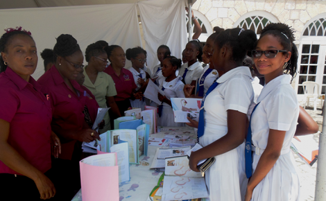 Students of the Mount Alvernia High School in Montego Bay visit the information booth at a health fair hosted by the St. James Midwives on May 5, at Sam Sharpe Square. The event was in observance of International Midwife Day.