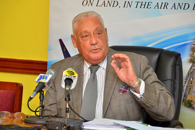 Minister of Transport and Mining, Hon. Mike Henry, responds to questions posed during a post-Sectoral Debate press briefing on Thursday (April 13), at the Ministry's Maxfield Avenue offices in Kingston.
