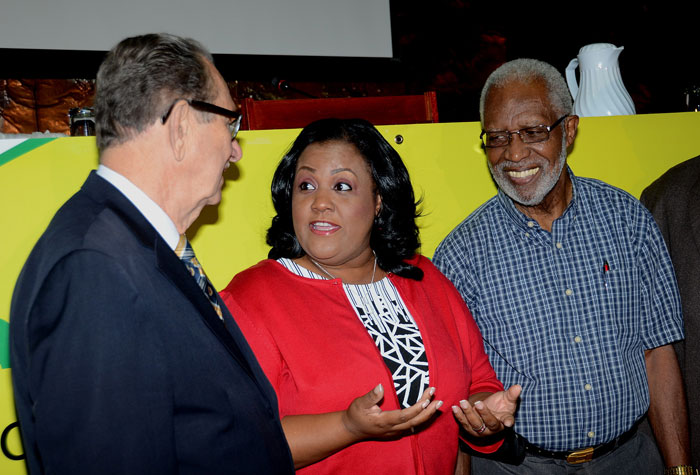 Minister with Responsibility for Sports, Hon. Natalie Neita Headley (centre), makes a point  to Chairman, Jamaica Anti-Doping Commission, Hon. R. Danny Williams (left), at the Jamaica Anti Doping Commission's symposium, held at the Jamaica Conference Centre on January 29.  At right is General Secretary for the Jamaica Boxing Board of Control, Leroy Brown.