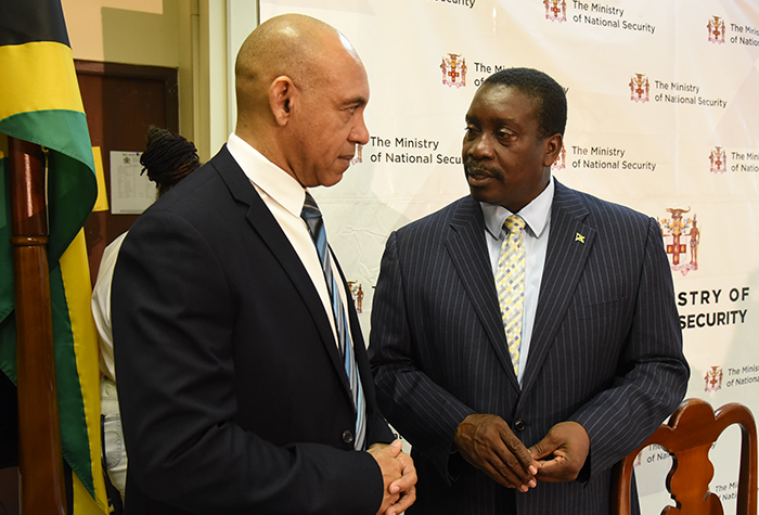 National Security Minister, Hon. Robert Montague (right), converses with newly appointed Firearm Licensing Authority (FLA) Chairman, National Security Advisor, Major General (Ret'd), Antony Anderson, during a press conference at the Ministry's New Kingston offices on Friday (October 20) to announce the new five-member FLA Board
