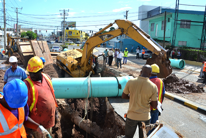 Work teams from the National Water Commission (NWC) and the National Works Agency (NWA) are working overtime to repair a damaged section of roadway along Constant Spring Road in St. Andrew.