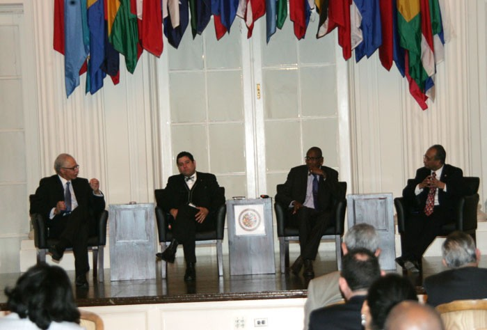 Chairman of the Governor's Commission on Caribbean Affairs for the State of Maryland, Ambassador Curtis Ward (left), makes a point during a panel discussion held after Wednesday's (Dec. 11) screening of the documentary 'Forward Home, the Power of the Caribbean Diaspora', held on at the Organization of American States (OAS) in Washington DC.  The other panelists (from 2nd left) are: Chairman of the Caucus of CARICOM Ambassadors and Ambassador of Trinidad and Tobago to the United States, His Excellency Dr. Neil Parsan; Lecturer at the University of the West Indies (UWI), Dr. Keith Nurse; and Assistant General Secretary to the OAS, His Excellency Albert Ramdin.