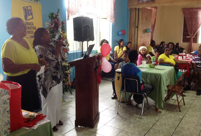 Director of the Mount Olivet Boys' Home, Sonia Lowe (left) and Assistant Director, Dionne Harriott, address  the Home's annual prize giving ceremony held at the Home, recently. The Jamaica Information (JIS) and the YB Afraid Foundation have adopted the Home and they make regular visits there to share gifts and time with the boys.