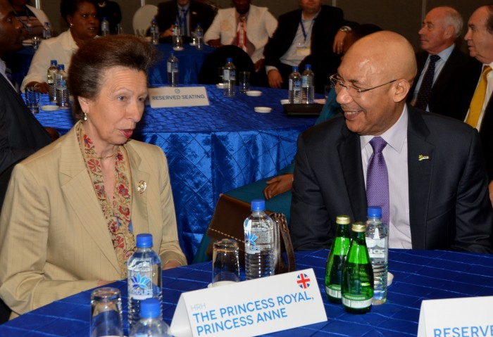 Her Royal Highness, Princess Royal, Princess Anne, shares a light moment with Governor General, His Excellency the Most Hon. Patrick Allen, at the closing ceremony of the Caribbean-Canada Emerging Leaders' Dialogue (CCELD), at the Pegasus Hotel on Friday (October 2).