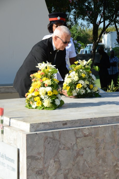 Minister of Education, Hon. Rev. Ronald Thwaites, lays a wreath at the shrine of National Hero, the Rt. Excellent Sir Alexander Bustamante, in honour of the 132nd anniversary of his birth, during a floral tribute at National Heroes Park, in Kingston, today (February 24). Rev. Thwaites represented Prime Minister, the Most Hon. Portia Simpson Miller.