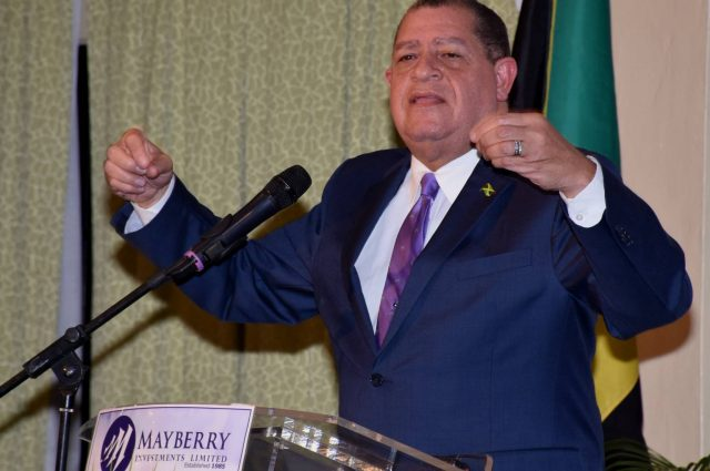 Finance and Public Service Minister, Hon. Audley Shaw, emphasizes a point while addressing Mayberry Investments Limited's monthly investor forum at the Knutsford Court Hotel in New Kingston on Wednesday (January 18).