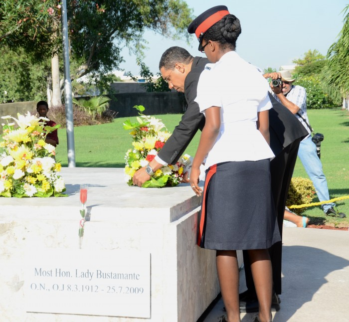 Leader of the Opposition, Andrew Holness (right), places a wreath at the shrine of National Hero, the Rt. Excellent Sir Alexander Bustamante, in honour of the 132nd anniversary of his birth, during a floral tribute at National Heroes Park, in Kingston, today (February 24). Observing is Constable Shaneika Murray-Bartley.