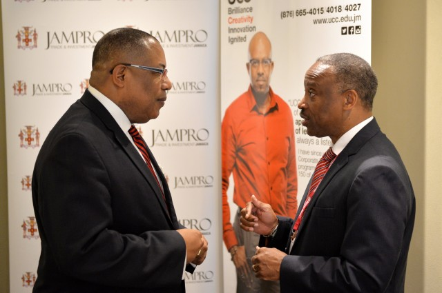 Industry, Investment, and Commerce Minister, Hon. Anthony Hylton (left), is engaged in discussion with Jamaica Promotions Corporation (JAMPRO) Chairman, Milton Samuda, prior to the start of Monday's (June 15) Business Leaders Power Breakfast at Hilton Rose Hall Hotel in Montego Bay, St. James. The breakfast formed part of scheduled activities for the 6th Biennial Jamaica Diaspora Conference, being held from June 13 to 18, at the Montego Bay Convention, under the theme: 'Jamaica and The Diaspora: Linking for Growth and Prosperity'.