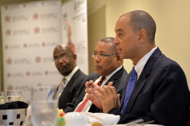 Industry, Investment, and Commerce Minister, Hon. Anthony Hylton (centre), and President, University College of the Caribbean (UCC), Dr. Winston Adams (left), listen to a presentation by GraceKennedy Limited Chief Executive Officer, Don Wehby, during Monday's (June 15) Business Leaders Power Breakfast at Hilton Rose Hall Hotel in Montego Bay, St. James. The breakfast formed part of scheduled activities for the 6th Biennial Jamaica Diaspora Conference, being held from June 13 to 18, at the Montego Bay Convention, under the theme: 'Jamaica and The Diaspora: Linking for Growth and Prosperity'.