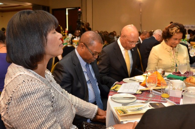 Governor General, His Excellency the Most Hon. Sir Patrick Allen (2nd right); Prime Minister the Most Hon. Portia Simpson Miller (left); Custos of St. Andrew, Hon. Marigold Harding (right); and Chairman, National Leadership Prayer Breakfast (NLPB) Committee, Rev. Dr. Stevenson Samuels, hold hands in prayer, at the NLPB held this morning (January 16), at the Jamaica Pegasus Hotel, New Kingston.