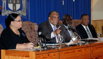 Finance and Planning Minister, Dr. the Hon Peter Phillips (2nd left), emphasizes a point while addressing journalists at Tuesday's (April 22) post-Budget media briefing at Jamaica House, where he elaborated on aspects of his opening presentation in the 2014/15 Budget Debate in the House of Representatives on April 17. Listening keenly are: Minister with responsibility for Information, Senator the Hon. Sandrea Falconer (left);  Financial Secretary, Ministry of Finance and Planning, Devon Rowe; and Minister without Portfolio in the Ministry, Hon. Horace Dalley.