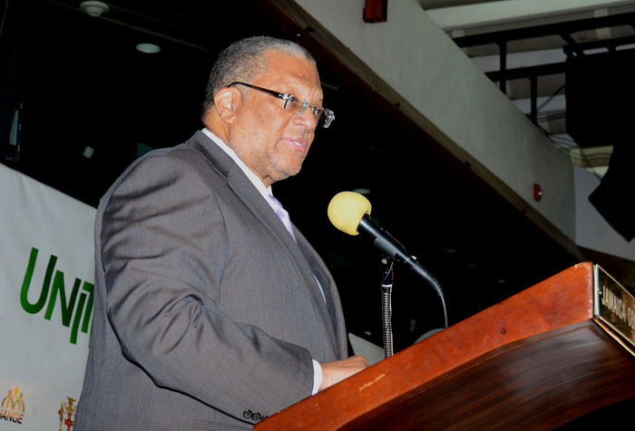 Minister of Finance and Planning, Hon. Dr. Peter Phillips, delivers the keynote address at the 'Unite for Change' National Forum on Youth Violence Prevention, which was held on January 30 at the Jamaica Conference Centre, downtown Kingston.