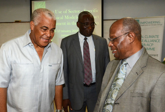 Minister of Water, Land, Environment and Climate Change, Hon. Robert Pickersgill (left), converses with Executive Director, Caribbean Community Climate Change Centre (CCCCC), Dr. Kenrick Leslie (right), following the opening ceremony of a regional training workshop on climate change on January 6, on the University of the West Indies' (UWI) Mona campus. Looking on is Director of Climate Change in the Ministry, Albert Daley.