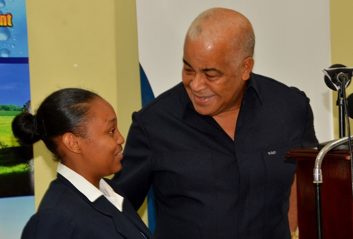 Minister of Water, Land, Environment and Climate Change, Hon. Robert Pickersgill (right), has a light moment with fifth form student at Ardenne High School, Ronella Peralto, during the official launch of the Adaptation Programme and Financing Mechanism Project at the Hotel Four Seasons in Kingston on Thursday, September 24.