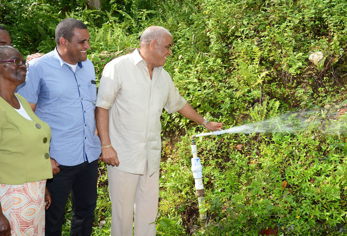Water, Land, Environment, and Climate Change Minister, Hon. Robert Pickersgill (right), performs the symbolic commissioning of the $60 million Mile Gully/Warwick Castle water supply system in St Mary on Thursday (November 28). Sharing the moment are: President, Mile Gully/Warwick Castle Benevolent Group, Ceceline Day (left); and Member of Parliament for Western St. Mary, Joylan Silvera.