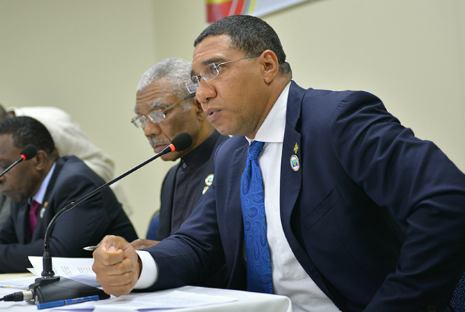 Prime Minister, the Most Hon. Andrew Holness (right), emphasises a point as he addresses the post CARICOM Press Conference on Thursday (July 6) in St. George's, Grenada. Others (from left) are: Prime Minister of Grenada, and incoming CARICOM chairman, Dr. The Hon. Keith Mitchell; and President of Guyana, and outgoing CARICOM chair, His Excellency David Granger.