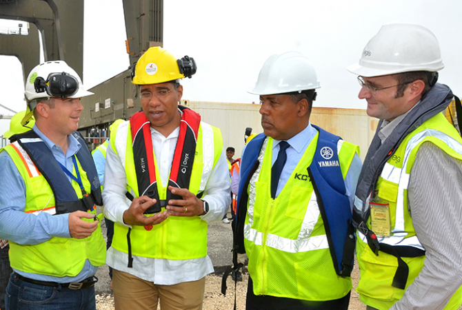 Prime Minister the Most Hon. Andrew Holness (second left) in discussion EPC Contractor and Project Director, Aurelien Delevoye (left) during a tour of expansion works being undertaken by the Kingston Freeport Terminal Limited (KFTL) at Port Bustamante on Friday, May 19. Observing from second right are: President and Chief Executive Officer of the Port Authority of Jamaica, Professor Gordon Shirley and Project Manager, Eric Fernagu.