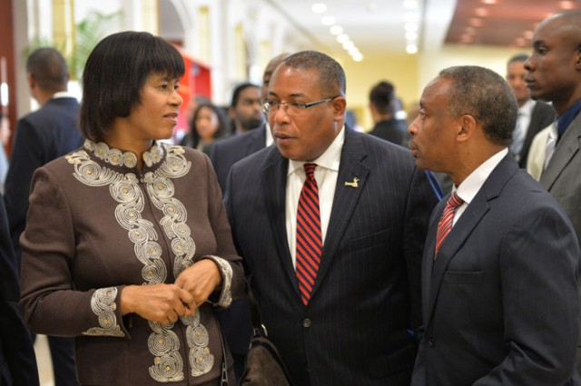 Prime Minister, the Most Hon. Portia Simpson Miller (left), is in conversation with Minister of Industry, Investment and Commerce, Hon. Anthony Hylton (centre) and Chairman of Jamaica Promotions Limited (JAMPRO), Milton Samuda, at the 2nd Jamaica Investment Forum on March 11 at the Montego Bay Convention Centre in St. James.
