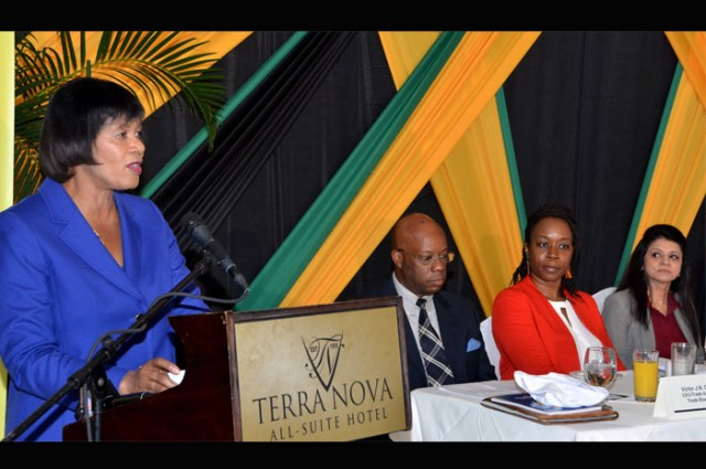 Prime Minister Portia Simpson Miller (left) speaking at the launch of the National Export Strategy, Phase II at the Terra Nova Hotel in Kingston on Thursday August 20. Listening intently are from left, Trade Administrator/CEO of the Trade Board, Mr. Victor Cummings; Advisor (Trade Competitiveness) Trade Division Commonwealth Secretariat Ms. Yinka Bandele; and Dr. Rashmi Banga, Adviser and Head of Trade Competitiveness Section, Commonwealth Secretariat.