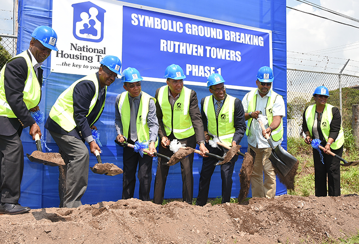 Prime Minister, the Most Hon. Andrew Holness (centre), breaks ground for the National Housing Trust's $4.1-billion Ruthven Towers housing development on Ruthven Road in St. Andrew, on Friday, September 22. Others (from left) are Custos Rotulorum for Kingston, Hon. Steadman Fuller; NHT Managing Director, Martin Miller; Minister without Portfolio in the Ministry of Economic Growth and Job Creation, Hon. Dr. Horace Chang; NHT Chairman, Dr. Nigel Clarke; Member of Parliament for South East St. Andrew, where the project is located, Julian Robinson; and Custos Rotulorum for St Andrew, Hon. Patricia Dunwell.