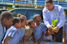 Prime Minister, the Most Hon. Andrew Holness (centre), explains the importance of trees to students of the Seaward Primary and Junior High School during a National Tree Planting Day exercise at the school on Olympic Way, St. Andrew today (October 7).