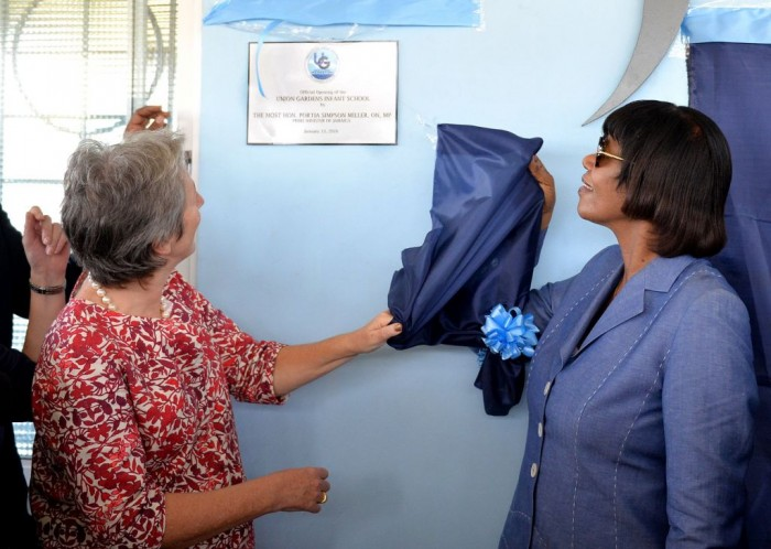 Prime Minister, the Most Hon. Portia Simpson Miller (right); and Head of Delegation for the European Union (EU) in Jamaica, Ambassador Paola Amedei, unveil a plaque at a ceremony to officially open the new state-of-the-art Union Gardens Infant School in South West St. Andrew on Wednesday, January 13. Construction of the school was completed in September last year, through a $174 million public-private investment partnership, which included support of the Jamaica Social Investment Fund, through its EU Poverty Reduction Programme.